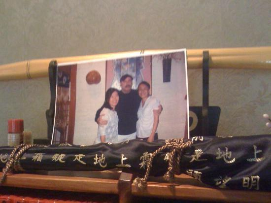 Musasi Japanese Restaurant : This is the shrine to John Travolta found at the restaurant. Incense is burnt to honor his spiri