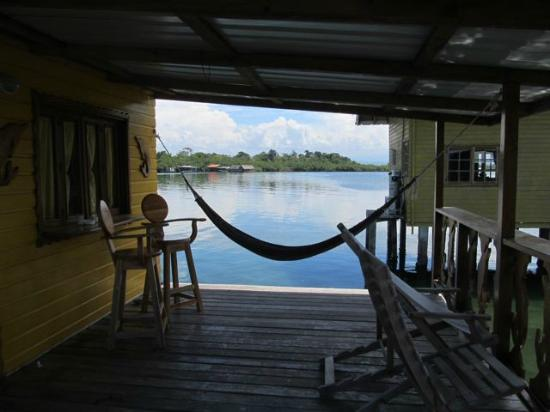 ‪‪Bahia Del Sol‬: Hammock and seating area on front porch of cabin‬