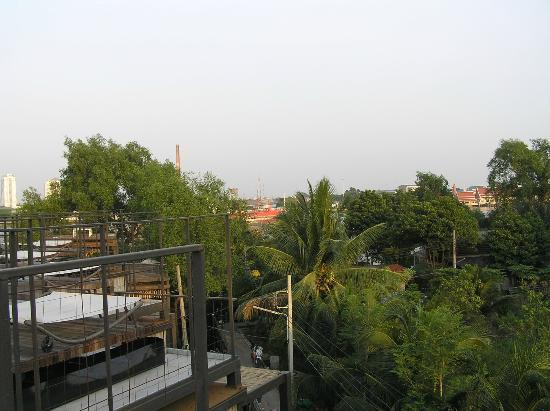 Bangkok Tree House: View towards temples and river from rooftop relax area