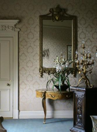 Coombe Abbey Hotel: Interior view of the Lady Craven Suite, door to ensuite on the left, the walls lined with silk.