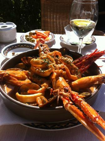 Plaza de Los Naranjos: A seafood dish on the plaza