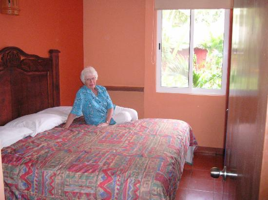 Hotel Hacienda Blue Bay: The king bed.  Also two single beds in a separate part of the suite