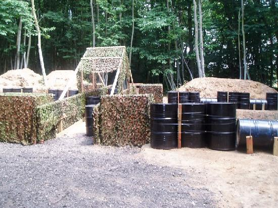 Delta Force Paintball: Advance over the bridge, or stay where you are?
