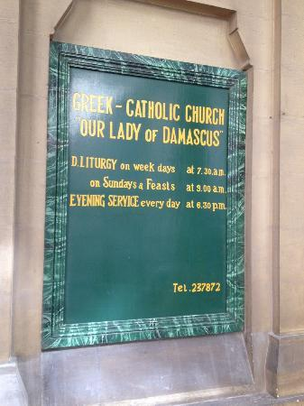 Our Lady of Damascus: Greek Catholic Church Mass times notice board