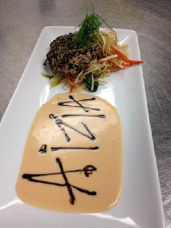 The Cafe: sesame crusted ahi tuna with lemon guava sauce and stir fry vegetables