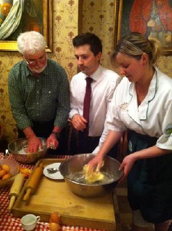 Hotel Sarmata: Hotel Owner, Chris & His Assistant with VBT Bikers During Cooking Demonstration