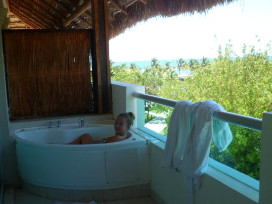 Enjoying the jacuzzi picture of bluebay grand esmeralda for Blue bay grand esmeralda deluxe v jardin