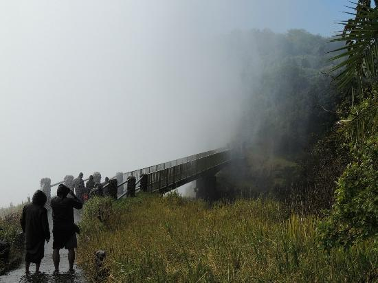 Wilderness Safaris Toka Leya Camp: Very wet bridge crossing on tour of the Falls