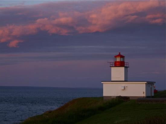 The Lighthouse on Cape d'Or: The lighthouse at sunset
