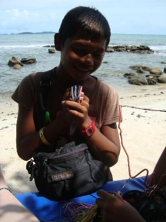 The New Coasters: local boy selling wares on beach