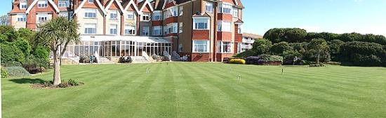 Hydro Hotel Eastbourne: Part of a panoramic sweep imnage of the pleasant grounds
