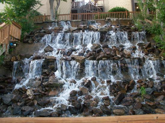 The manmade waterfall on the property  Picture of The Wharf by