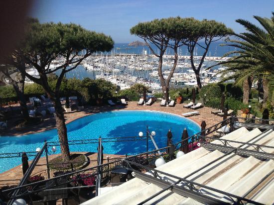 Baglioni Resort Cala del Porto: The view from our balcony, pool area and marina