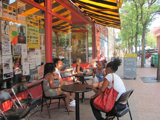 Youth enjoying the day outside of AS220's 115 Empire St location