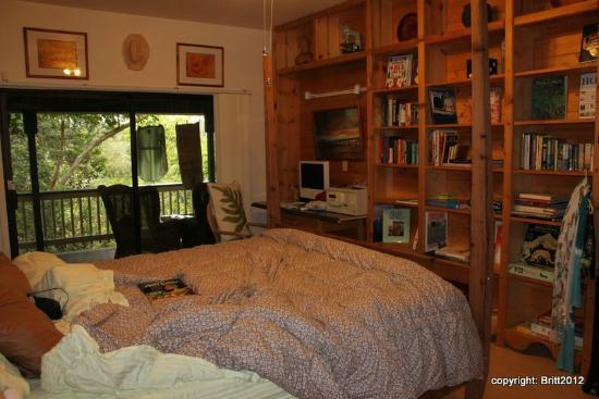Kauai Country Inn: our big bedroom -- note the bookshelves with lots of books