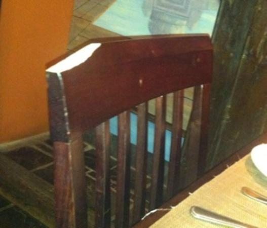 Bhandaris Indian Restaurant: Chipped chair