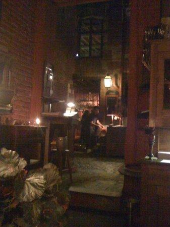 La Cave aux Fioles: Cobbles and oak leading to the bar