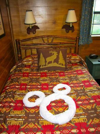 The Campsites at Disney's Fort Wilderness Resort: Cute towel art on the camping themed bed.