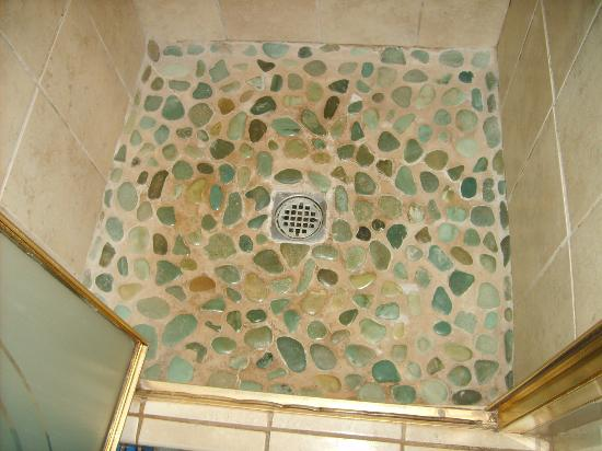Ocean Breeze Hideaway: Stone Flooring in the Ocean Room's Shower