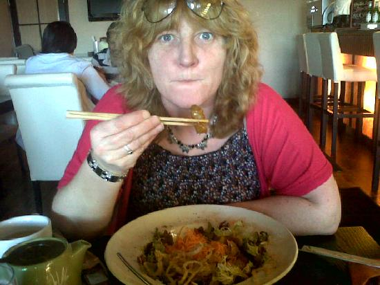 Yoko at the Jet Centre: Eating with traditional chopsticks