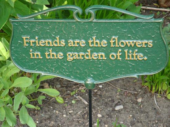 Garden Gate Bed and Breakfast: Sign in one of the flower beds