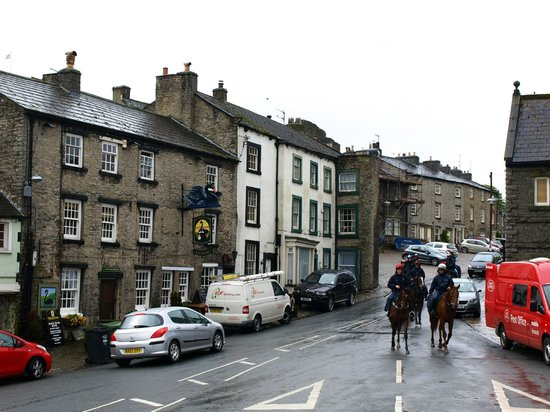 The Black Swan Hotel: Horses pass on the main street, which is usually quiet.