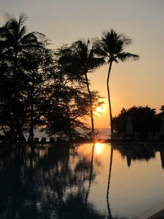 Sunset with view of pool
