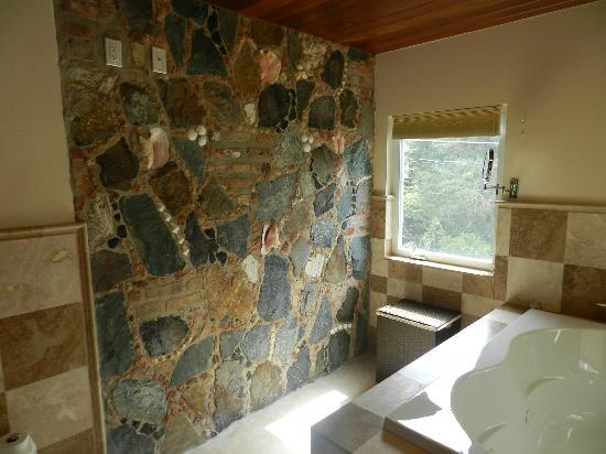 Sea Shore Allure: Stone & sea shell wall in the master bath