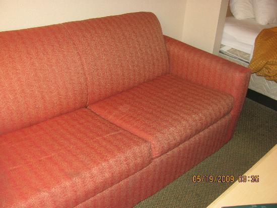 Quality Suites: couch with depressed cushion