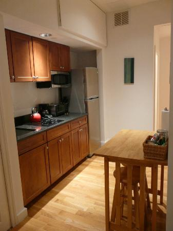 The Boston Christopher: Kitchen with very small eat/work table with 2 stools
