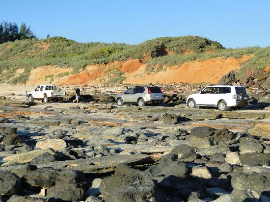 Cable Beach: 4x4 vehicles heading north over the rocks