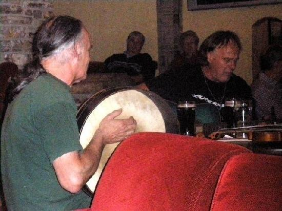 Corcreggan Mill: Ernine playing bodhrán in local pub's traditional music session