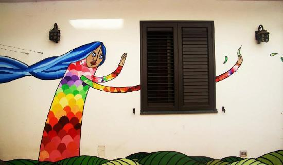 Mille Fiori : una donna, murales d'autore