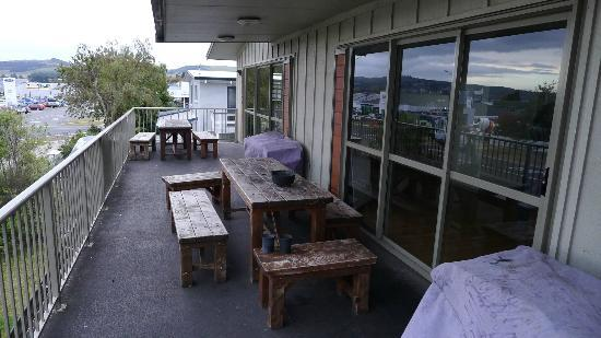 Tiki Lodge: Outdoor area on second floor - decent view of city, distant view of the lake
