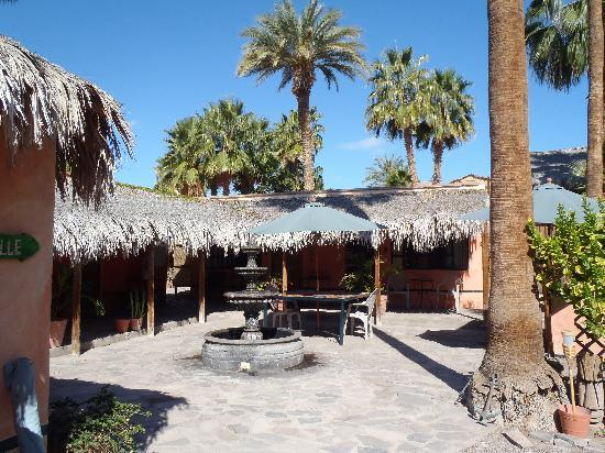 Iguana Inn: Walking toward the courtyard.  The rooms border the courtyard.