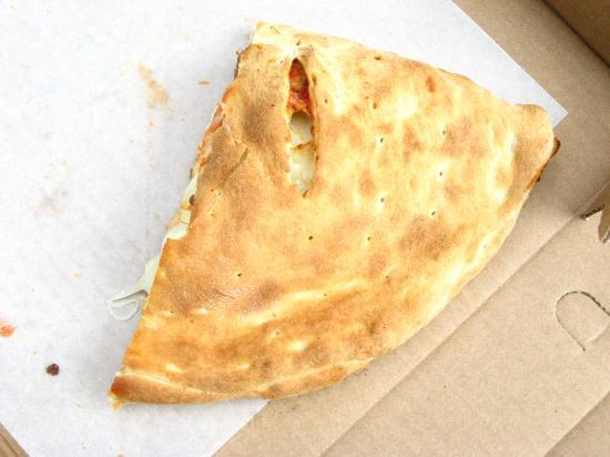 La Casa De Pizza: 1/2 of my small calzone - I devoured half before the picure - I could not help it!