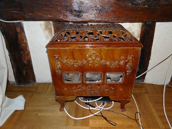 La Boulangerie: Ancien poêle (décoratif) dans une des chambres