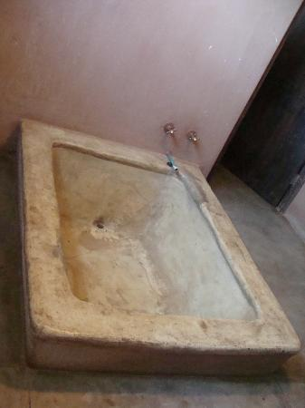 Honeyguide Tented Safari Camps: Your 'custom' bathtub is made of cement... mind the gravel rash!