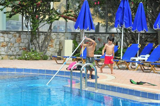 Lefka Apartments: Nikolas & Panagiotis Helping the Pool Man