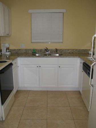 Villas at Fortune Place: Kitchen with granite countertops