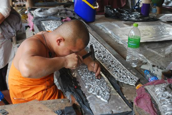 Chiang Mai Adventure Tour: metal carving at progress to decorate the temple