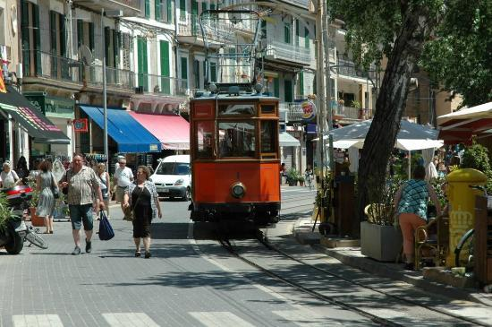 Es Raco des Port: Views of the trams and sea from outside tables