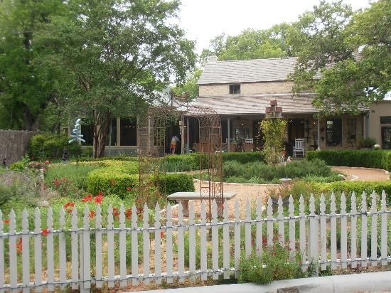 Fredericksburg Herb Farm - Sunday Haus Cottages: View of Farm Haus Bistro from parking lot