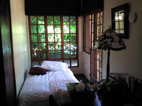Village Green Guest House: This is the single bed in the room with another door