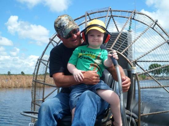Capt Mitch's - Everglades Private Airboat Tours: Captain letting my son steer the boat