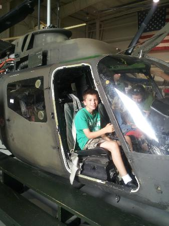 The Aviation Museum of Kentucky: My son in the OH-58A Kiowa.  The control yokes work!
