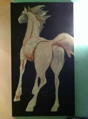 Hotel Emona Aquaeductus: Do you need to wake up with a horse's butt looking at you? I don't. not sure why this painting w