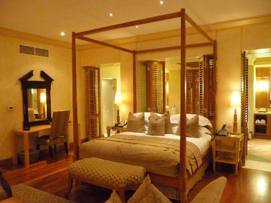 Saxon Hotel, Villas and Spa: View of our bed and entrances to the bathroom
