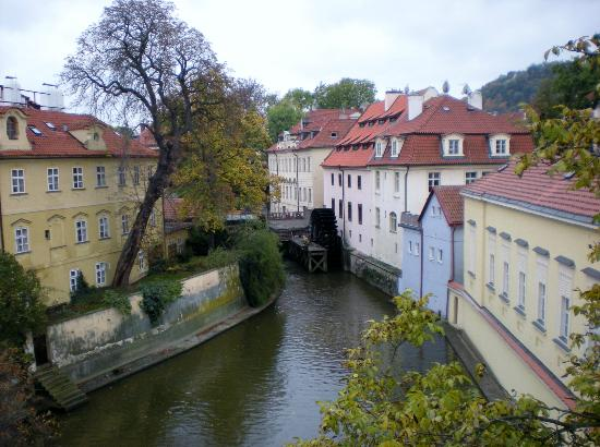 Mala strana: The Grand Priory Square and slow moving mill in the Devils Stream