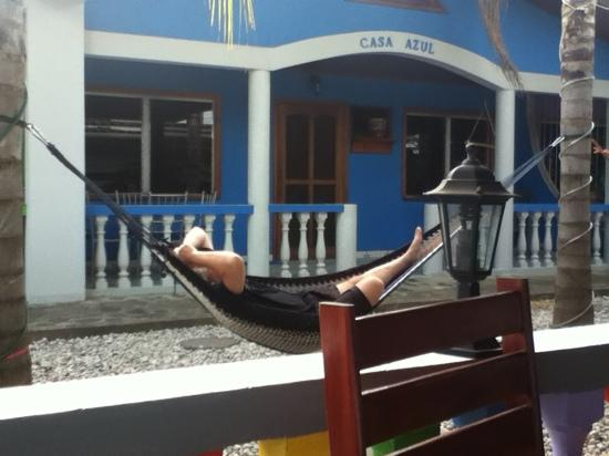 Hotel Rainbow Village: My husband enjoying a siesta in the garden.